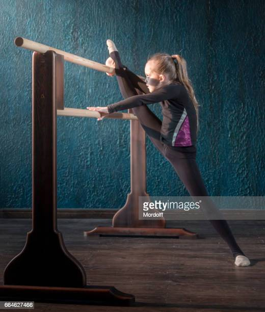 little strong gymnast. overcoming yourself - little girls leotards stock photos and pictures