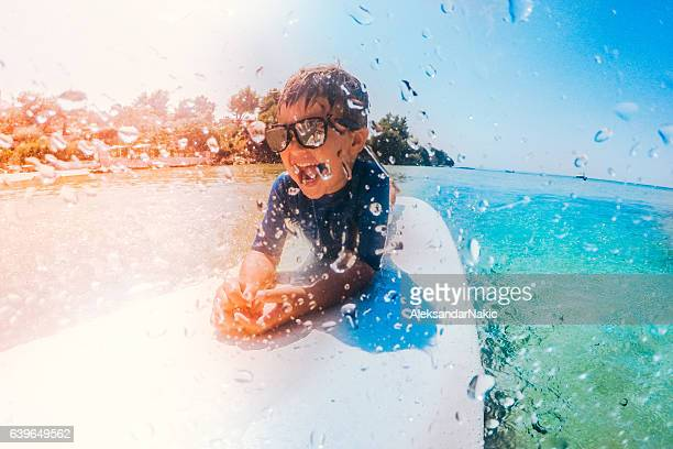 little surfer boy - wassersport stock-fotos und bilder