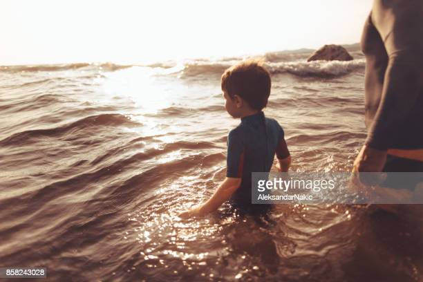 Little surfer conquering the waves