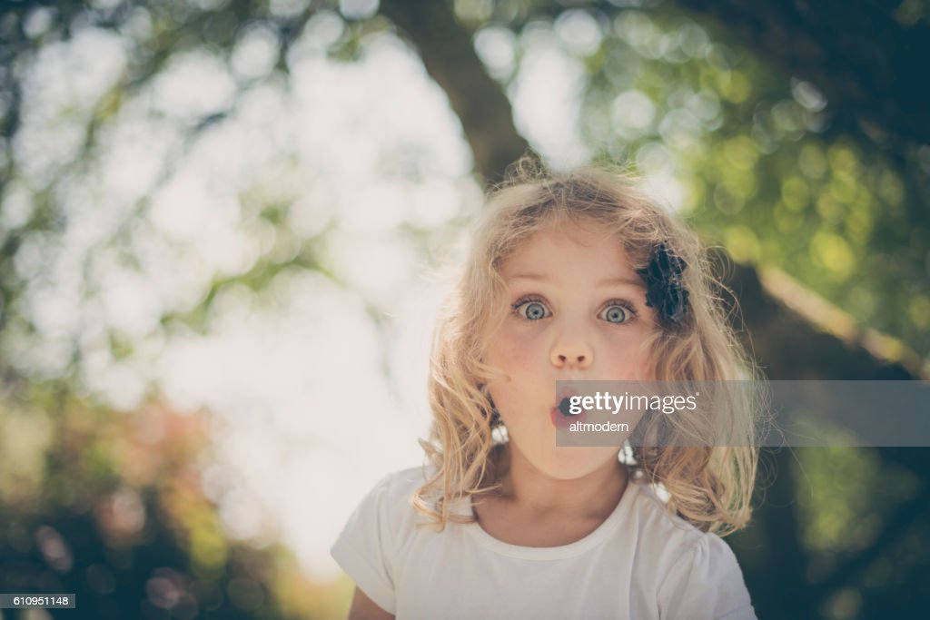 little surprised blond girl with blue eyes : Stock-Foto