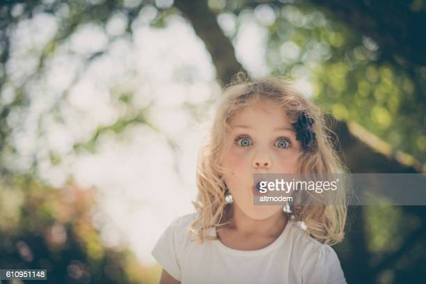 little surprised blond girl with blue eyes - überraschung stock-fotos und bilder