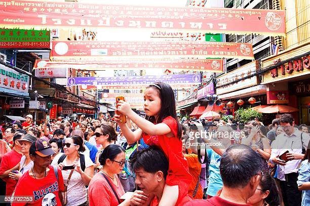 Little Thai girl with mobile at chinese new year