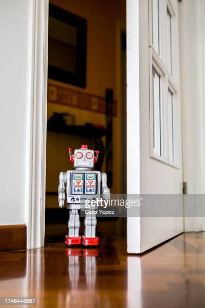 little tin robot peeking from kids door