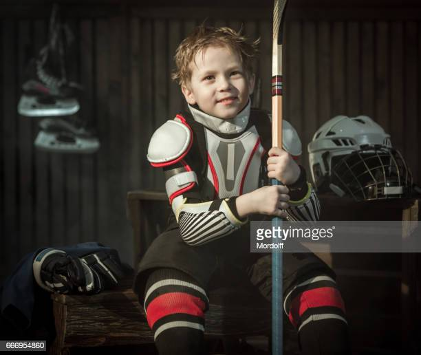 Little Tired Hockey Player Resting After Game