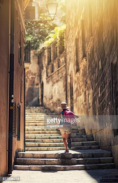 little tourist girl visiting mediterranean town. - palma majorca stock photos and pictures