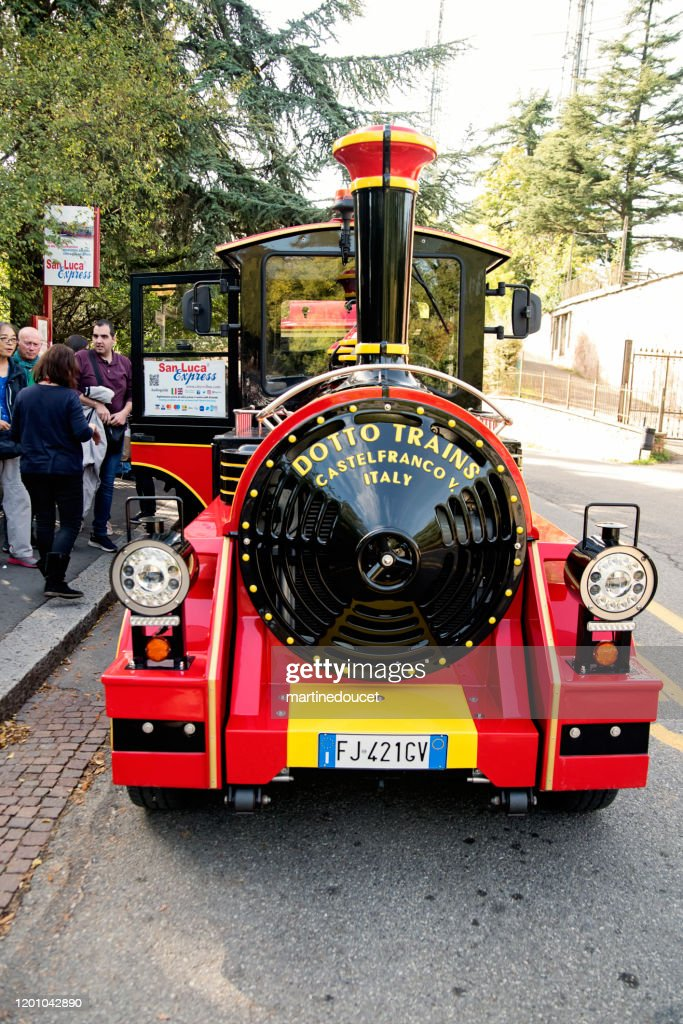 Little tourist train San Luca Express in the streets of Bologna, Italy. : Stock Photo