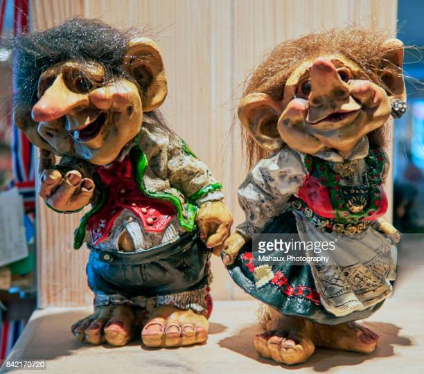 little troll wooden sculptures as souvenirs from geiranger - troll stock photos and pictures