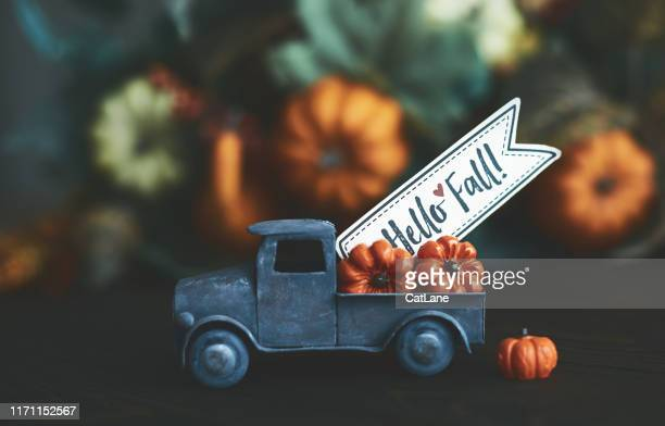 little truck with load of miniature pumpkins for fall and thanksgiving - season stock pictures, royalty-free photos & images