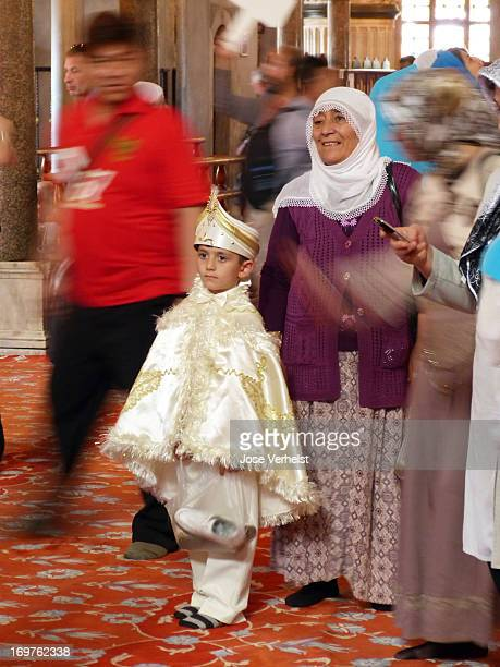 CONTENT] Little turkish boy in The Blue Mosque Istanbul He is dressed up in white satin suit with spangled cap probably on his way to an islamic...
