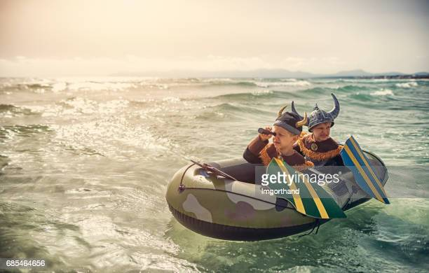 little vikings on a boat looking for someone to raid - mythology stock pictures, royalty-free photos & images