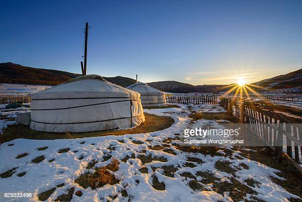 a little village in mongolia with traditional yurts ( gers) standing in the snow in late winter - モンゴル ストックフォトと画像