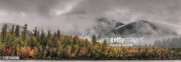 little whiteface emerges from the cloud cover - lake placid stock pictures, royalty-free photos & images