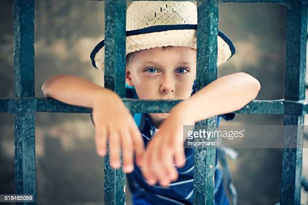 little wild west bandit jailed - child behind bars stock pictures, royalty-free photos & images