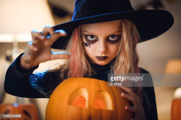 little witch - halloween kids stock photos and pictures