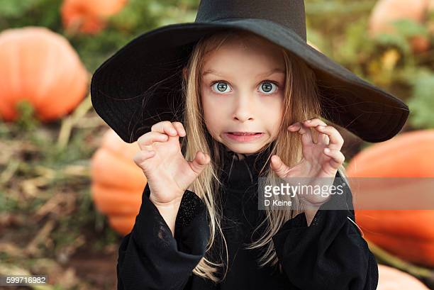 little witch - halloween party stock photos and pictures