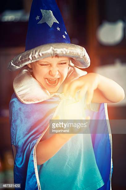 little wizard practicing fire spells - imgorthand stock photos and pictures