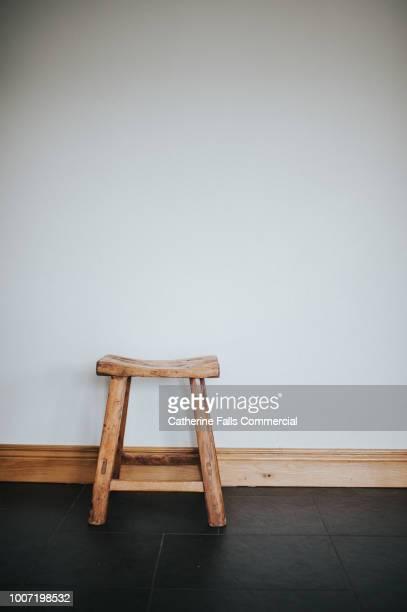 little wooden stool - hocker stock-fotos und bilder