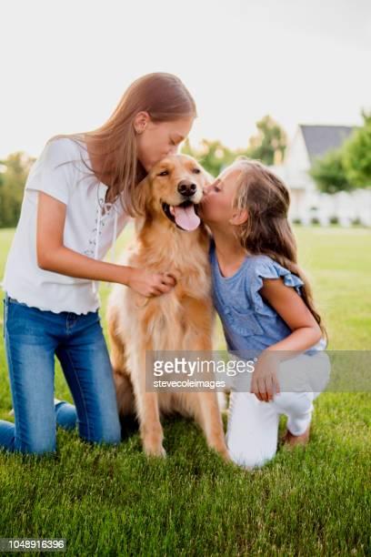 Littles girls with pet dog.