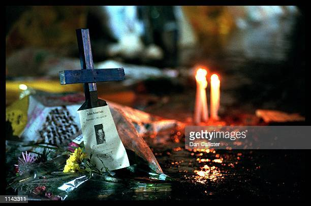04/25/99 Littleton Colorado A cross marking the life of John Robert Tomlin who was gunned down in Columbine High School Picture by DAN CALLISTER...