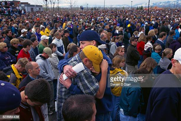 Some 70000 people gather at a memorial service to honor the people killed in the Columbine High School shooting