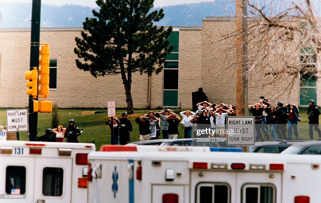Columbine High School Students Exiting with Police After Shootings : News Photo