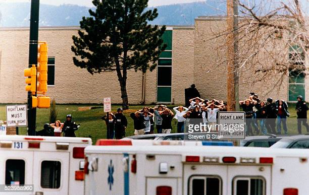Students run out of the Columbine High School as 2 gunmen went on a shooting spree killing fifteen including themselves
