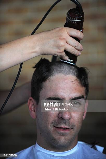 Littleton firefighter Eric Horvat gets his head shaved in support of Jeff Christ South Metro FIrefighter/Paramedic Sheryl West said that after a...