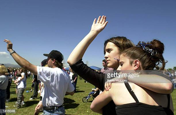 Littleton High students Erin Boehm left and Erica Bristow embrace April 20 2000 during the benediction at a memorial service held on the anniversary...
