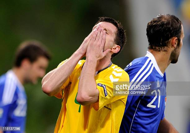 Lituania's Tadas Kijanskas reacts after missing an action during their EURO 2012 qualifying group I football match Liechtenstein vs Lithuania at...