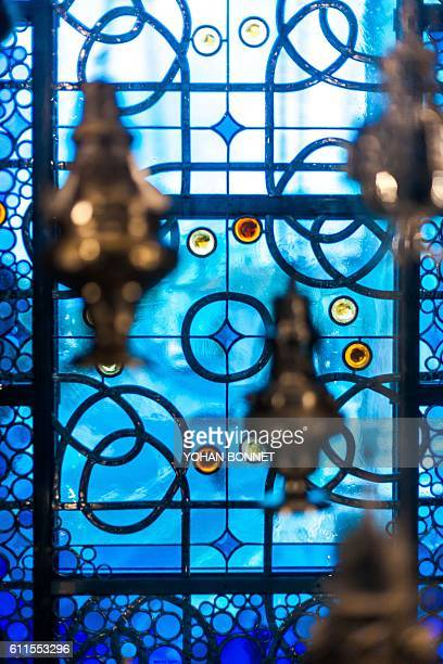 Liturgical objects and a stainedglass window are showcased in an artwork by French artist JeanMichel Othoniel on September 30 2016 in the cathedral...