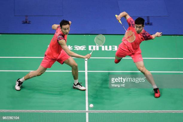 Liu Cheng and Zhang Nan of China hits a return during their man's doubles Semi final match against Takeshi Kamura and Keigo Sonoda of Japan at the...