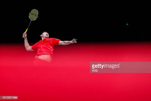 Liu Cheng of China competes in the Men's Doubles eighth-final match against Hiroyuki Endo and Yuta Watanabe of Japan on day four of TOTAL BWF World...