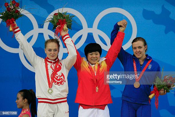 Liu Chunhong of China center Oxana Slivenko of Russia left and Natalya Davydova of the Ukraine right celebrate after receiving medals in the women's...