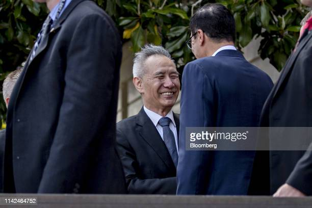 Liu He China's vice premier center smiles while being greeted by Steven Mnuchin US Treasury secretary center right outside the Office of the US Trade...