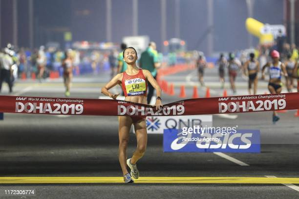 Liu Hong of China crosses the finish line to win the Women's 20km Race Walk during the IAAF World Athletics Championships 2019 at the Al Corniche...