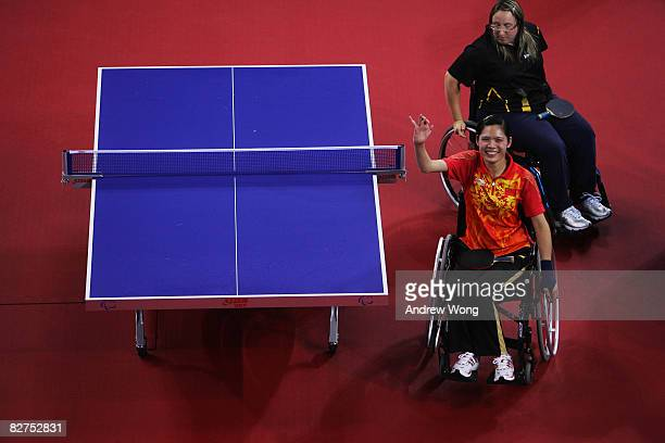 Liu Jing of China celebrates after beating Pamela Pezzutto of Italy in the final of the Women's WIC12 Table Tennis event at the Peking University...