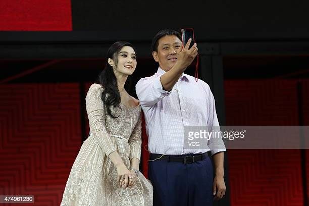 Liu Jun president of Lenovo's Mobile Business Group takes a selfie with actress Fan Bingbing during the Lenovo Tech World at China National...
