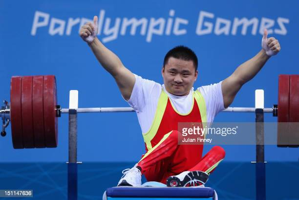 Liu Lei of China celebrates a world record lift and takes gold in the Men's 67.5kg competition on day 4 of the London 2012 Paralympic Games at ExCel...