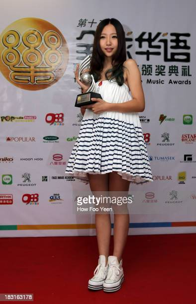 Liu Mei Ling of China poses with her Most Potential New Artiste Award at back stage during the13th Global Chinese Music Awards at Putra Stadium on...