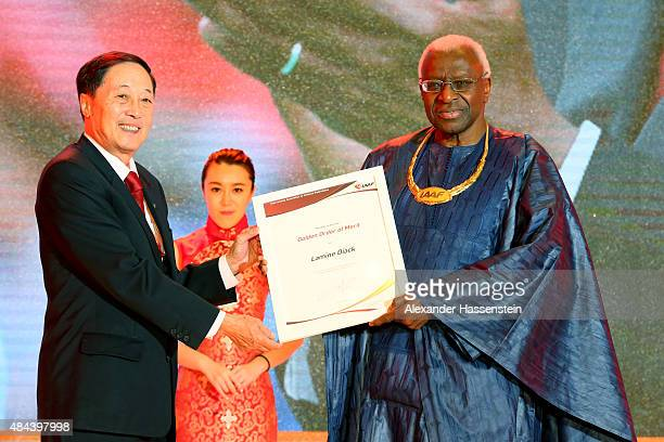 Liu Peng Minister of Sports ot the People's Republic of China hands over the Golden Order of Merit to IAAF President Lamine Diack during the IAAF...