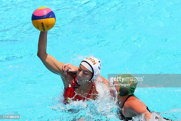 Liu Ping of China in action with Kieran Paley of South Africa during the Women's Water Polo first preliminary round match between China and South...