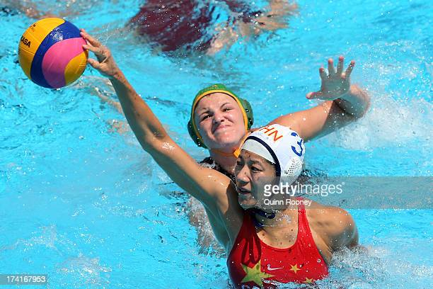 Liu Ping of China passes the ball under pressure during the Women's Water Polo first preliminary round match between China and South Africa during...