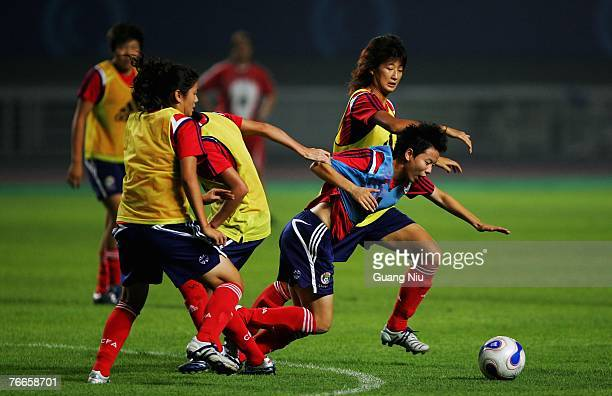 Liu Sa of China and her teammates attend a training session for the FIFA 2007 World Cup in China at Wuhan Sports Center Stadium on September 11, 2007...