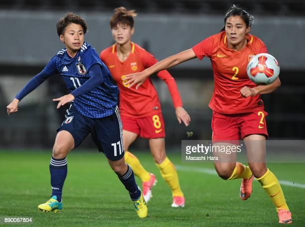 Liu Shanshan of China and Mina Tanaka of Japan compete for the ball during the EAFF E1 Women's Football Championship between Japan and China at...