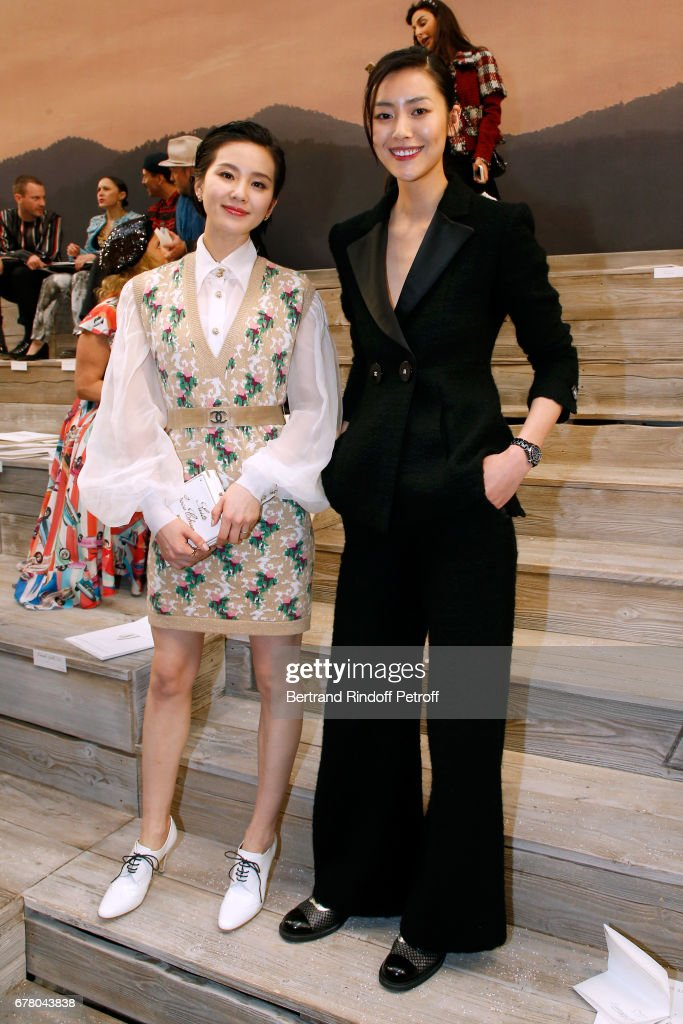Liu Shishi and Liu Wen attend the Chanel Cruise 2017/2018 Collection Show at Grand Palais on May 3, 2017 in Paris, France.