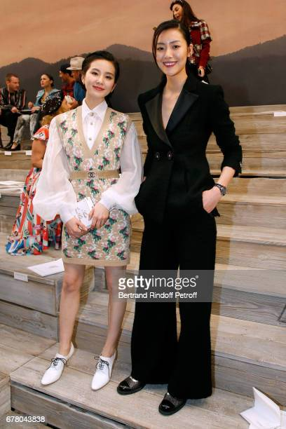 Liu Shishi and Liu Wen attend the Chanel Cruise 2017/2018 Collection Show at Grand Palais on May 3 2017 in Paris France
