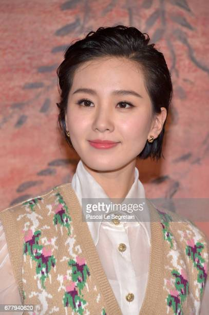 Liu Shishi attends the Photocall of the 'Chanel Cruise 2017/2018 Collection' at Grand Palais on May 3 2017 in Paris France