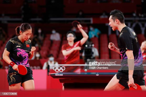 Liu Shiwen and Xu Xin of Team China react during their Mixed Doubles Gold Medal matchon day three of the Tokyo 2020 Olympic Games at Tokyo...