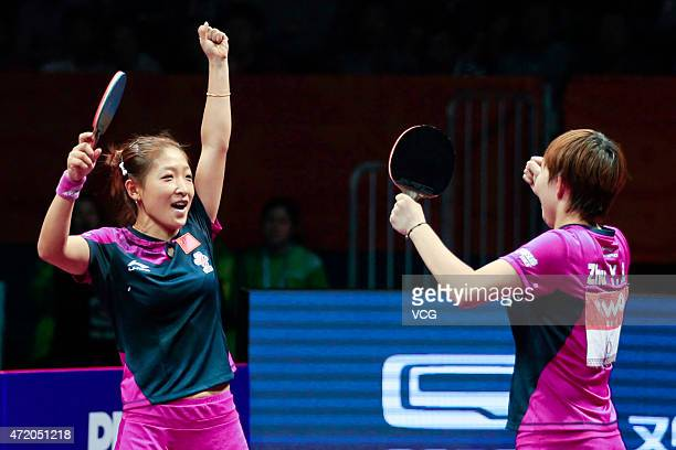 Liu Shiwen and Zhu Yuling of China celebrate after winning women's doubles final match against Ding Ning and Li Xiaoxia of China on day eight of the...