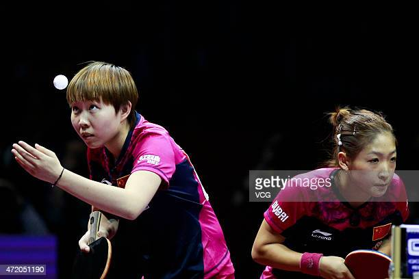 Liu Shiwen and Zhu Yuling of China compete against Ding Ning and Li Xiaoxia of China during women's doubles final match on day eight of the 2015...